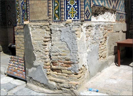 Samarkand. Fragments of the wall in the Sher Dor Madrasah are falling apart