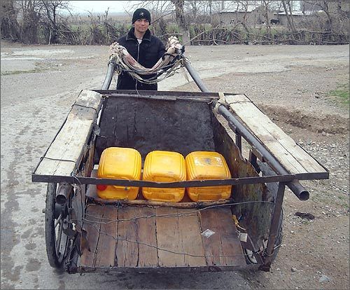 At the photo: 18 year old Bahtiyar Jabborov. He never attended school in his life. He cannot write or read. He is a water carter. Photo by author, March 2009