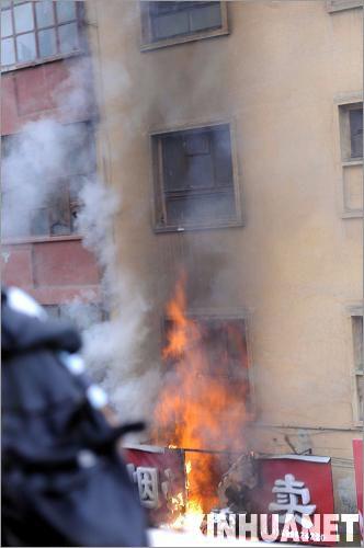 Беспорядки в СУАР. Фото Синьхуа